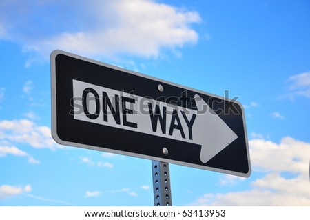 One Way Sign against blue sky