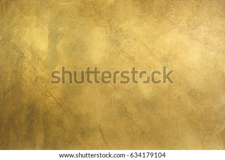 Brushed brass plate background texture Royalty-Free Stock Photo #634179104