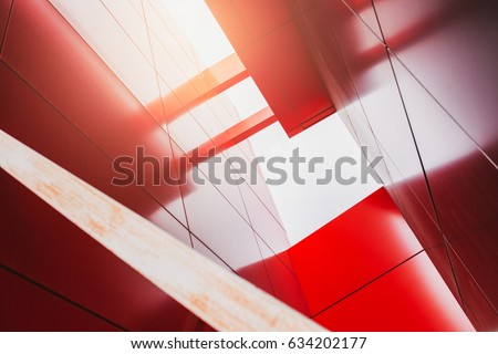 Abstract background view of a modern office center building with geometric line and sunset, bottom view #634202177