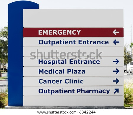 Hospital sign showing direction to different medical services