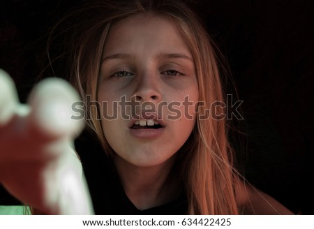 Very horrible girl on a black background. #634422425