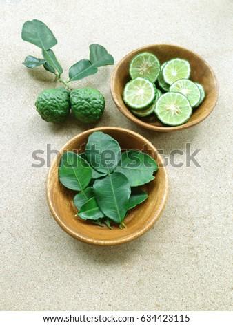 Kaffir Lime or Bergamot and Leaf on  plywood background #634423115