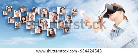 social network and global contact concept. Woman wearing virtual reality goggles headset glasses #634424543