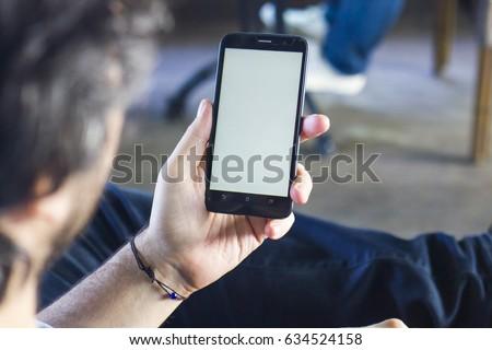 Man Holding Smart phone - Mobile Phone Mock Up #634524158