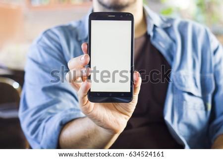 Man Holding Smart phone - Mobile Phone Mock Up #634524161