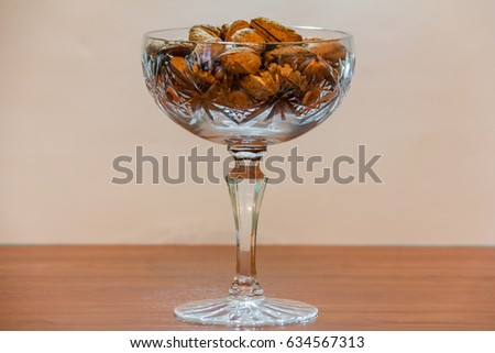 Almond in a shell filled with wine glass #634567313