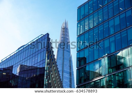 LONDON - APR 20 : The Shard building at sunset pictured on April 20th, 2017, in London. The Shard opened to the public on February 2013. Standing 309m, the Shard is the tallest building in Europe. #634578893