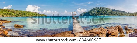 Tropical sea panorama with pier on small island  #634600667