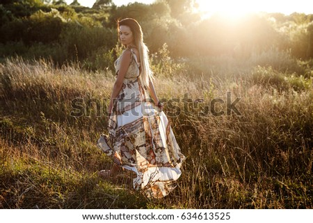 girl on river beach in long dress in summer #634613525