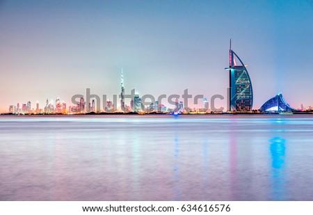 Dubai skyline at dusk, UAE. Royalty-Free Stock Photo #634616576
