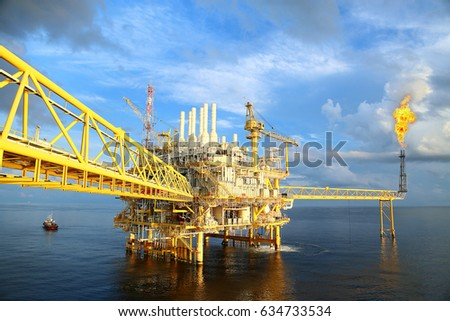 Offshore construction platform for production oil and gas. Oil and gas industry and hard work industry. Production platform and operation process by manual and auto function from control room. #634733534