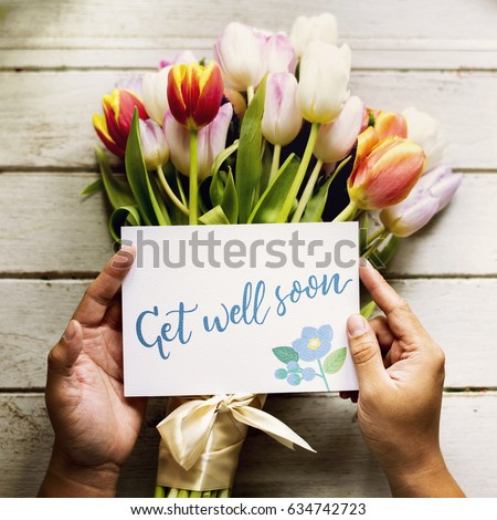 Hand Holding Show Get Well Soon Card with Tulips Flowers Background #634742723