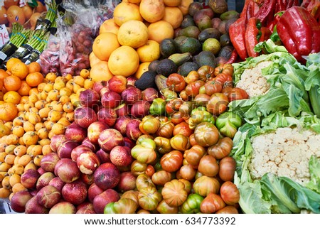 Vegetables and fruit on the market counter #634773392
