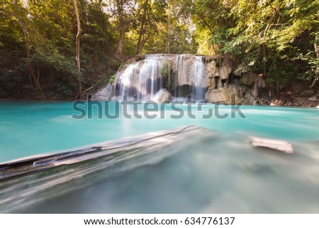 Natural blue stream waterfall in tropical deep forest, natural landscape background #634776137
