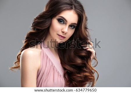closeup beauty portrait of young woman with natural makeup and hairstyle. spa and care. #634779650