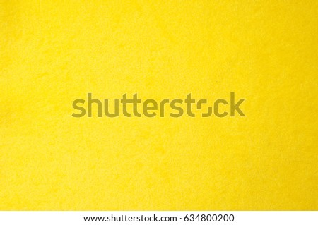 Texture background pattern. Woolen yellow fabric, cloth for a blanket, outer clothing.  Closeup horizontal fragment #634800200