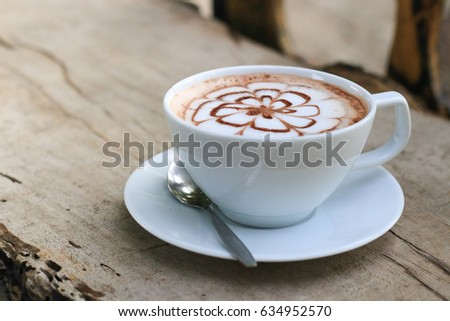 cup of hot cocoa on wood table #634952570