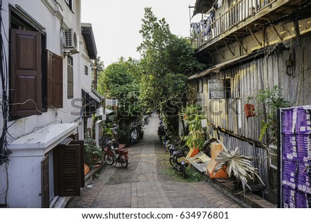 LUANG PRABANG, LAOS - MAY 3, 2017: Alley way in old town Luang Prabang, Laos. #634976801