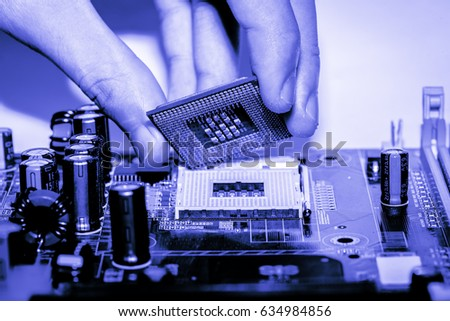 Close up of Electronic Circuits in Technology on   Mainboard background (Main board,cpu motherboard,logic board,system board or mobo) #634984856