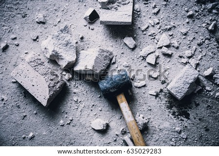 hammer smash with light brick mass break apart construction concept Royalty-Free Stock Photo #635029283
