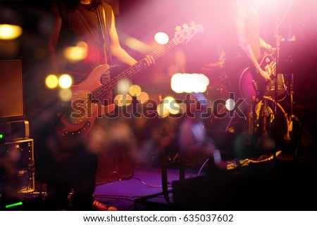 Guitarist on stage for background, soft and blur concept Royalty-Free Stock Photo #635037602