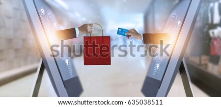 e-commerce, hand holding shopping bag and credit card from screen and global network, shopping and payments online concept, all on credit card are design up #635038511