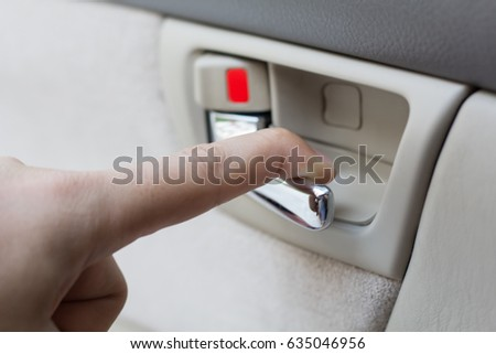 Opening the car door. Closeup of a hand selective focus and with a very shallow depth field. #635046956