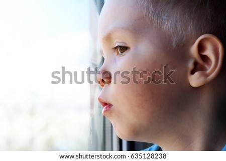 Adorable little blond kid boy sitting near window, baby #635128238