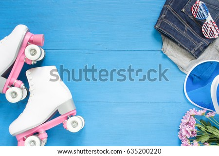 Sport, healthy lifestyle, roller skating background. White roller skates, clothing set, sunglasses and blue visor hat. Flat lay, top view.