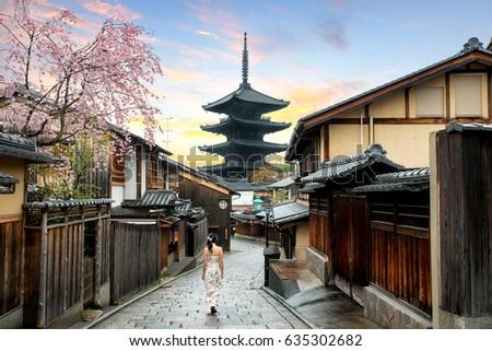 Asian woman walking Yasaka in street near Pagoda in the Morning, Kyoto, Japan #635302682
