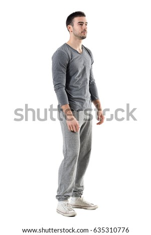 Side view of young sporty athletic man in sweatpants and sweatshirt looking away. Full body length portrait isolated on white studio background.  #635310776