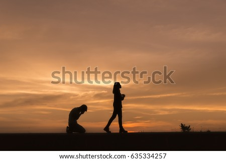 Silhouette of break up of couples love (sad man and woman),quarreling,anger and have something problems with sunset background in Thailand.Anger,unhappy,bad relationship concept.