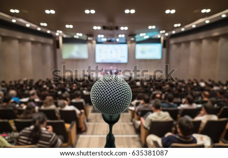 Microphone over the Abstract blurred photo of conference hall or seminar room with attendee background, Business meeting concept #635381087