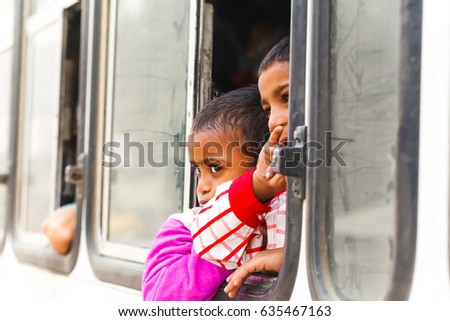 Children look out the bus window.India, Govardhan, November 2016 #635467163