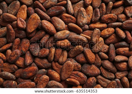Aromatic cocoa beans as background Royalty-Free Stock Photo #635514353