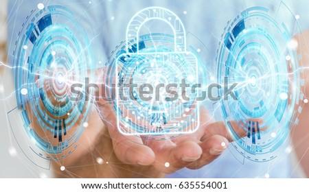 Businessman on blurred background using digital padlock to secure his datas 3D rendering #635554001