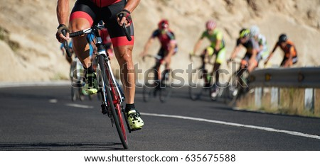 Cycling competition,cyclist athletes riding a race at high speed Royalty-Free Stock Photo #635675588