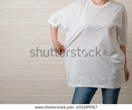 Young female in a white blank t-shirt  #635689067