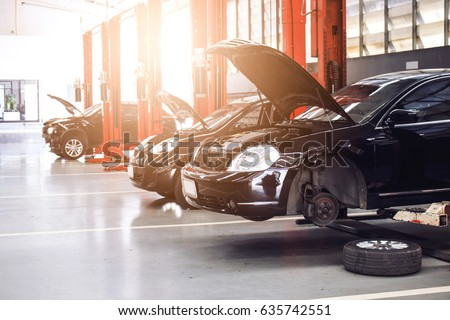 black car repair station with soft-focus in the background and over light Royalty-Free Stock Photo #635742551