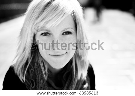 Young beautiful monochrome portrait of a blond girl. #63585613