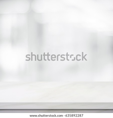 Empty white marble table over blur store background, Shop product and food display montage banner, wallpaper, mock up, template, poster #635892287
