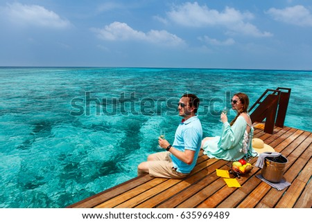 Romantic couple at tropical resort during honeymoon vacation #635969489