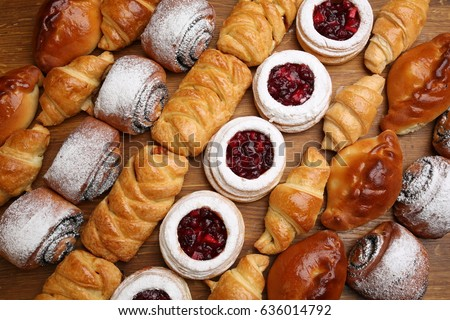 Sweet pastries, puff pastry, powdered sugar, nuts, jams, baked apples. #636014792