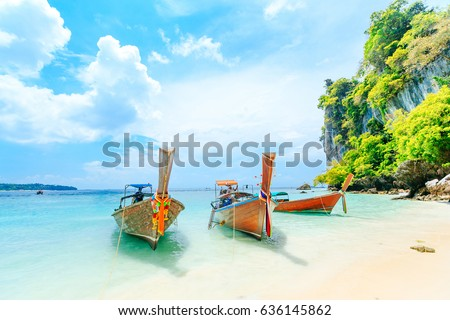 Longtale boat on the white beach at Phuket, Thailand. Phuket is a popular destination famous for its beaches. #636145862