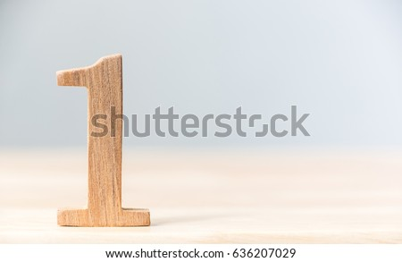 Sign number one material wood on table, Concept top winner success, Copy space Royalty-Free Stock Photo #636207029