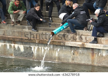 STOCKHOLM, SWEDEN - MAY 8, 2017: Annual release of young brown trout or Salmo trutta in Strommen. Stockholm #636278918