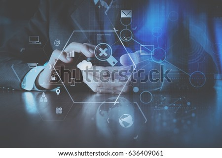 businessman hand working with modern mobile phone in modern office with virtual icon diagram #636409061