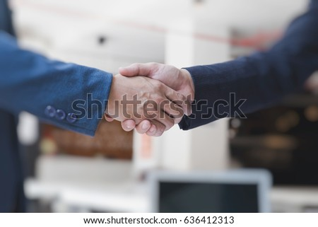 two businessman handshaking for successful deal after negotiation in meeting. business partnership corporate concept. #636412313