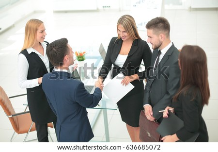 View from the top: business team standing in an office and shaki #636685072