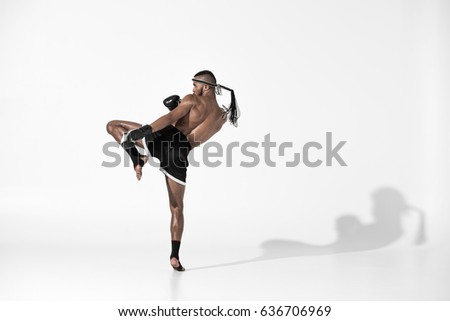 back view of muay thai fighter training isolated on white, fight club concept Royalty-Free Stock Photo #636706969